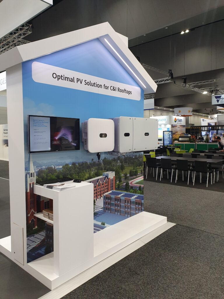 House shaped display unit with wall mounted product display and large format vinyl graphics.